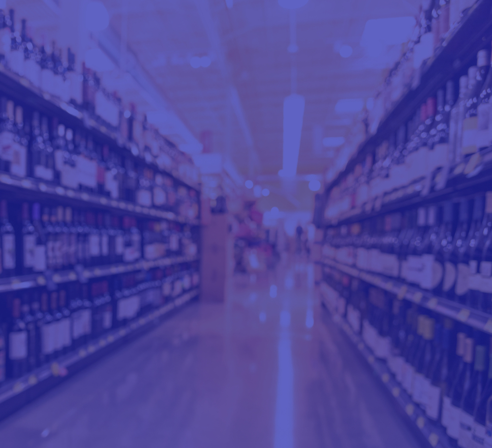 Blue image of aisle lined with bottles
